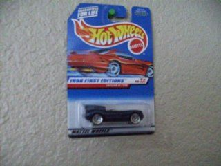 Hot Wheels Jaguar D Type #638 1998 First Editions on Red Card Wire Spoke Wheels Toys & Games