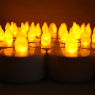 Shop BlueDot Trading LED Battery Operated Flameless Flickering Tea Lights, Amber, 24 Pack at the  Home D�cor Store